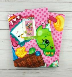 Shopkins Sneaky Beach Towel measures 28 x 58 inches
